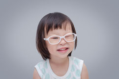 Little girl wearing eyeglasses and smiles stock photos