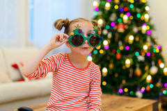 Little girl wearing funny Christmas glasses Royalty Free Stock Photography