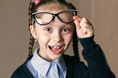 Little girl wearing glasses royalty free stock photos