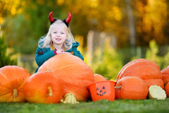 Little girl wearing halloween costume on a pumpkin patch Royalty Free Stock Image