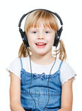 Little girl wearing headphones Stock Photo