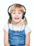 Little girl wearing headphones Stock Photo