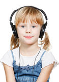 Little girl wearing headphones Stock Photography