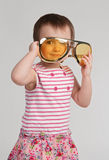 Little girl wearing huge glasses Stock Photos