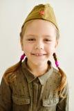 Little girl wearing military uniform Stock Photography