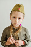 Little girl wearing military uniform Royalty Free Stock Photo