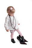Little girl wearing mothers shoes and jewelry Royalty Free Stock Image