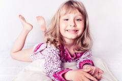 Little girl wearing a nightgown. Isolated on white Stock Image