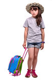 Little girl wearing palm hat with travel bag Stock Photos