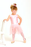 Little girl wearing a pink ballet outfit and dance Royalty Free Stock Image