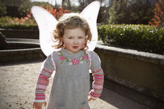 Little girl wearing pink butterfly wings Royalty Free Stock Photo