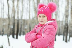 Little girl wearing pink clothes in winter park Royalty Free Stock Photography