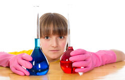 Little girl wearing pink gloves with flasks for chemistry Stock Photos