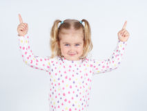 Little girl wearing  pointing by forefinger to somewhere up. Isolated Stock Photos