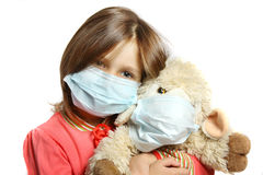 Little girl wearing a protective mask. A Little girl wearing a protective mask Stock Photo