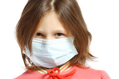 Little girl wearing a protective mask. A Little girl wearing a protective mask Stock Photos