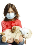 Little girl wearing a protective mask Stock Image