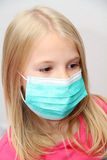 Little girl wearing a protective mask. Photo of the Little girl wearing a protective mask Stock Photo