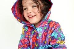 Little girl wearing rain coat. Adorable smiling female child wearing a rain coat Stock Photography