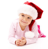 Little girl wearing red Christmas cap Stock Photos