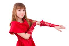 Little girl is wearing red dress and gloves. Royalty Free Stock Photos