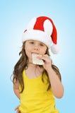 Little girl wearing red Santa hat Royalty Free Stock Photo