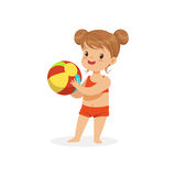 Little girl wearing red swimsuit playing with a ball, kids summer vacation colorful character vector Illustration Royalty Free Stock Image