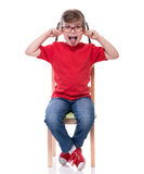 Little girl wearing red t-shirt and glass playing the ape Royalty Free Stock Photos