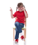 Little girl wearing red t-shirt and glass pointing to somewhere Stock Photos