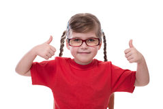 Little girl wearing red t-shirt and glass showing thumb Stock Photos