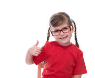 Little girl wearing red t-shirt and glass showing thumb Royalty Free Stock Photos