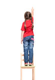 Little girl wearing red t-shirt and pointing to  something up hi Stock Photography
