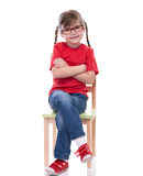 Little girl wearing red t-shirt and posing on chair Royalty Free Stock Photography