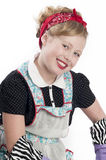 Little Girl Wearing Retro Apron Stock Photos