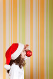 Little girl wearing santa hat Royalty Free Stock Photography