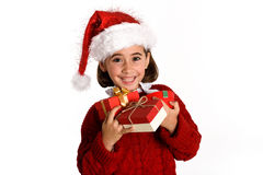 Little girl wearing santa hat carrying many gift boxes. For Christmas on white background Stock Photography