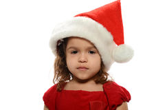 Little Girl wearing a Santa's hat Stock Photography