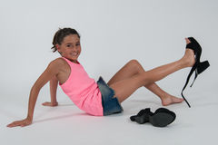 Little girl wearing the shoes of mom Stock Image