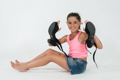 Little girl wearing the shoes of mom Stock Images