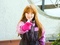 Little girl wearing snowsuit laughing royalty free stock photo