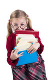 Little girl wearing spectacles holds books Royalty Free Stock Photos