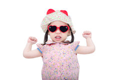 Little girl wearing sunglasses and hat over white Stock Photos