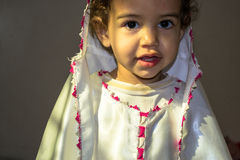 Little girl wearing traditional white dress Stock Photography