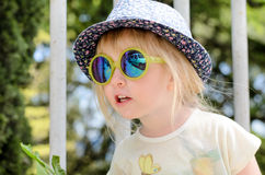 Little girl wearing trendy summer accessories Royalty Free Stock Photography
