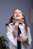 Little girl wearing up a necktie like a man Stock Photo