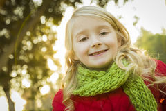 Little Girl Wearing Winter Coat and Scarf at the Park Stock Image