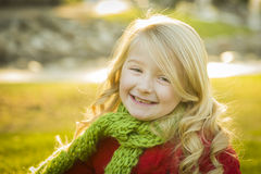 Little Girl Wearing Winter Coat and Scarf at the Park Stock Photo