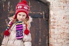 Little girl wearing winter outwear Royalty Free Stock Photo