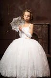 Little girl in wedding dress Stock Image