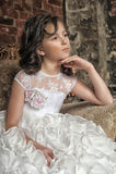 Little girl in wedding dress Stock Image